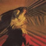 Cuori strappati. La Gaia Scienza. 1983. Dopo una fitta pioggia (un vero e proprio sipario d'acqua), al suono di misteriosi flauti armeni, s'alza di colpo un telone. Un'impermeabile grande un teatro. Guidarello vi si ficca dentro. E' la prima scena di Cuori Strappati. © Foto di Maria Causati, Pubblicata in «Frigidaire», n°32-33, luglio-agosto, 1983.