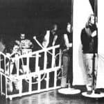 Moby Dick. Mario Ricci.1972. Marinai con le vele pronte per il mare, mentre Claudio-Achab costruisce una casa con le carte da gioco. © foto di Luigi Perrone