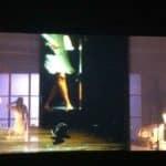 Città di Ebla.The dead. 2012. Composizione fotografica su più piani con donna di spalle sulla sinistra e dettaglio di gambe in alto al centroio. © foto di Laura Arlotti.